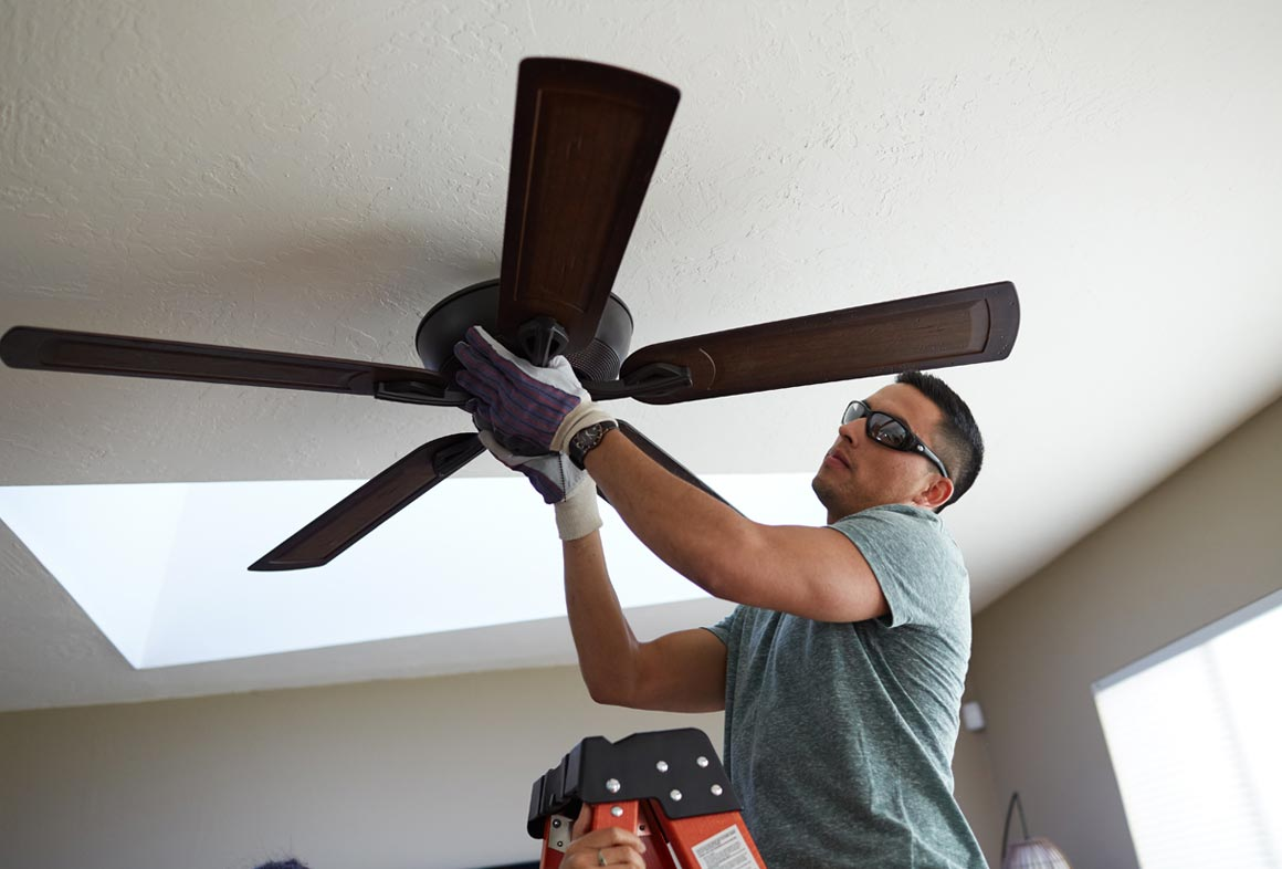 Ceiling fans can help you stay cooler when used with your AC